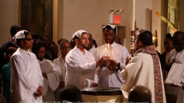 Redeemer Giving of Candle at Baptism 2019